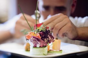 Moevenpick_Hotels_and_Resorts_Chef_preparing_food_for_thought