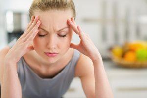 women-eyes-closed-STRESS-shutterstock_142814494-e1399846838570