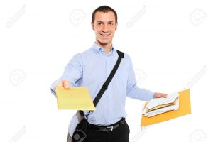 7322369-A-young-postman-delivering-mail-isolated-on-white-background-Stock-Photo