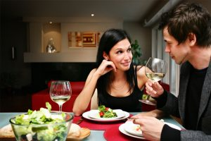 happy-couple-at-home-having-dinner