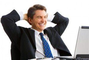 happy-man-looking-at-computer-300x203